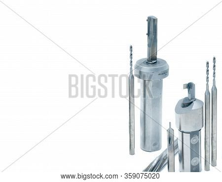 Special Tools Isolated On White Background. Made To Order Special Tools. Step Drill, Reamer, And End