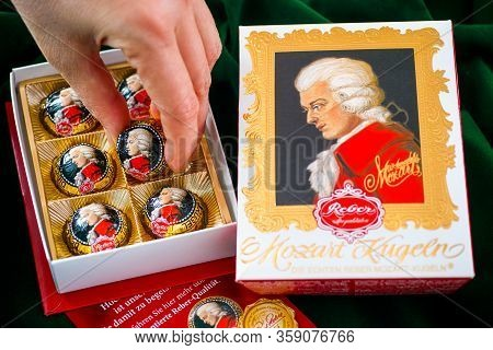Tambov, Russian Federation - February 14, 2020 Woman Hand Taking Mozart Candy From Open Candy Box. G