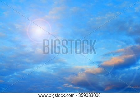 Blue sky background. Picturesque colorful clouds lit by sunlight. Vast sky landscape panoramic scene - colorful sky view in bright tones