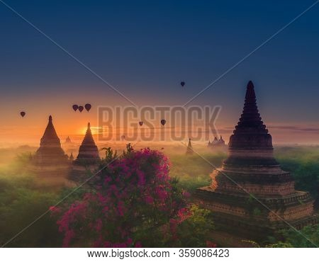 Hot Air Balloons At Sunrise Over Beautiful Bell-shaped Pagodas Bagan Myanmar