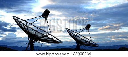 the satellite dish antennas on the sky