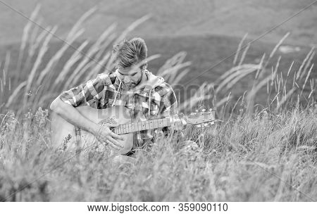 Face The Music. Acoustic Guitar Player. Country Music Song. Sexy Man With Guitar In Checkered Shirt.