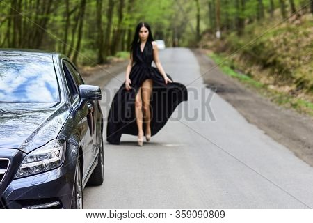 Sexy Girl Elegant Dress At Road. Escort Concept. Glamorous Girl And Luxury Car. Escort And Sexual Se