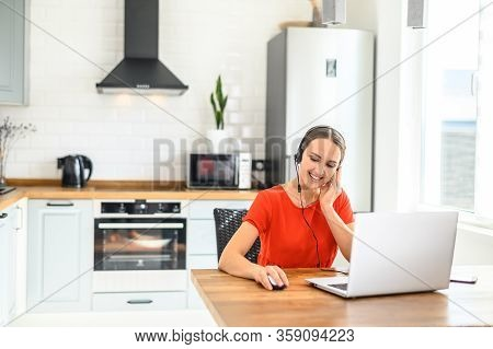 Remote Work From Home. Call-centre Worker. Portrait Of A Young Business Woman Working On Laptop Comp