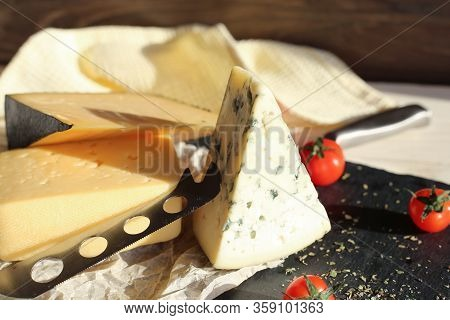 Hard Cheese And Dorblu Cheese On A Light Wooden Surface. Tasty Healthy Vegan Cheeses On The Table To