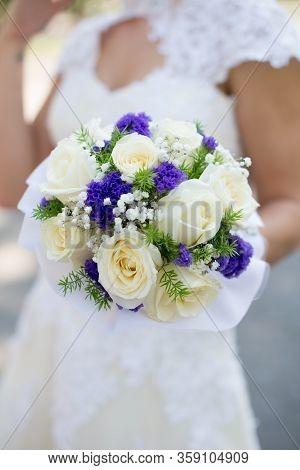 Beautiful Wedding Bouquet In Hands Of The Bride.
