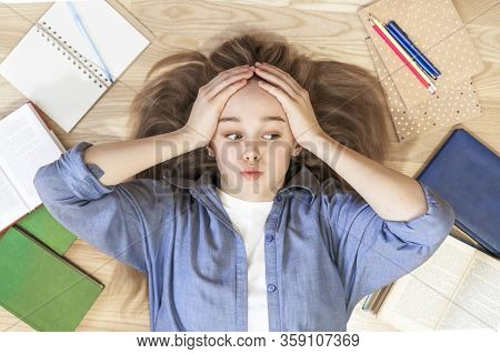 Stressed College Student Tired Of Hard Learning With Books In Exams Tests Preparation, Overwhelmed H
