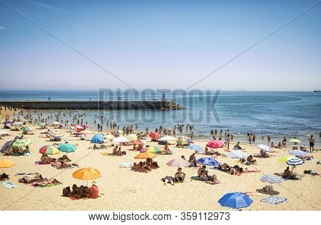 Lisbon, Portugal - July 26, 2016: Cascais Beach Near Lisbon In Portugal Packed Full Of Tourists And