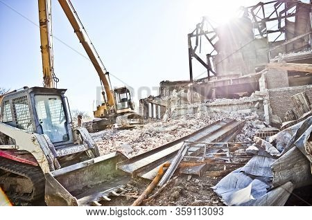 Building Demolition Site With Bulldozers And Rubble