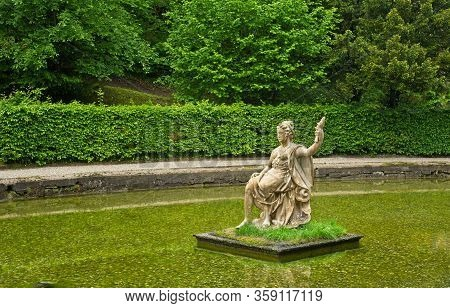 Salzburg, Austria - May 28, 2019: A Statue Of The Greek Goddess Amphitrite -- Holding Up A Fish -- S