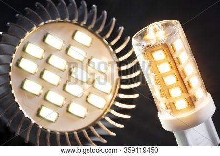 Illuminated Energy Saving G9 Led Light And An Illuminated Led Spotlight With A Black Background
