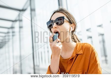 Asthmatic Woman Using Inhaler, Having An Asthma Attack Outdoors