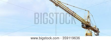 Construction Crane Works On Site, Street View. Construction Company Security Guarantor. Rental And S