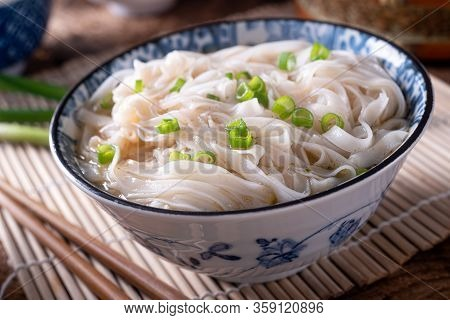 A Bowl Of Delicious Rice Noodle Pho With Scallions.