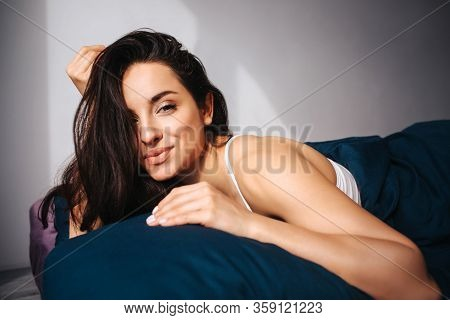 Young Beautiful Woman In Morning Bed At Home. Cheerful Positive Sexy Female Model Posingo On Camera