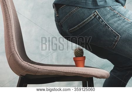 Man Sit On A Chair With Cactus. Hemorrhoids