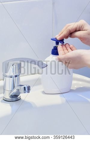 Unrecognizable Female Shows How To Wash Hands Properly. Woman Washs Hands With Soap. Scrubbing Hands