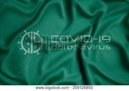 Coronavirus Covid-19 SARS Co-V design logo on a hospital sheet. World Health organization WHO introduced new official name for Coronavirus disease named COVID-19 SARS Co-V, dangerous virus.