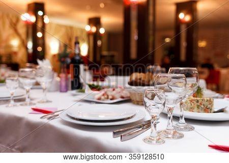 Restaurant Tables Set For Celebration. Many Food On The Festive Table