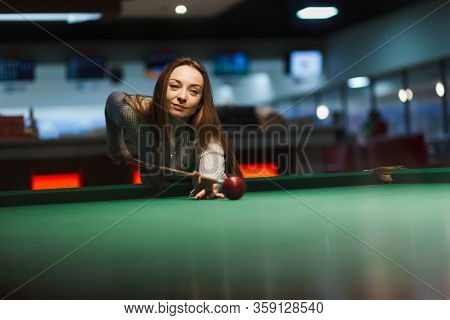 Girl Plays Billiards In The Club. Leasure Activity
