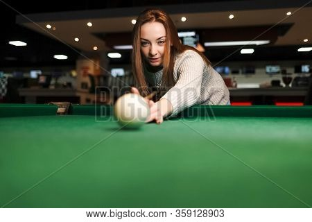 Concentrated Girl While Playing Billiards. Leasure Activity