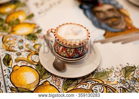 Romania, Bucuresti, 22 February 2020 Tasty Italian Cappuccino In Beautiful Cup On Table In Restauran