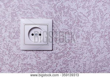Close Up Photo Of A White 220 Volt Power Socket With Copyspace. 220 Volt European Outlet