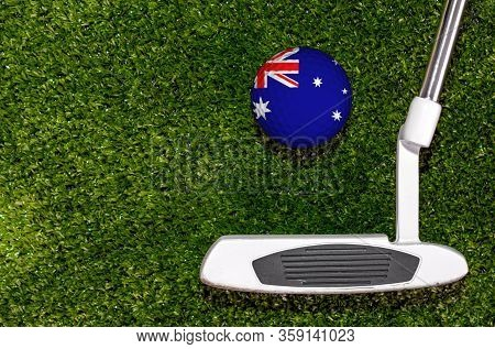 A Golf Club And A Ball With Flag Australia During A Golf Game.