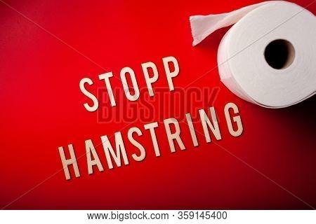 stopp hamstring norwegian word text wooden letter toilet paper on red background coronavirus covid-19