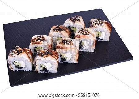 Traditional Fresh Japanese Sushi Rolls On A Black Stone Black Dragon On A White Background. Roll Ing