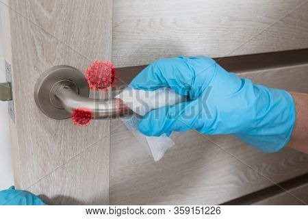 Wiping Door Knob With Antibacterial Disinfecting Wipe For Killing Coronavirus. Coronavirus Covid-19.