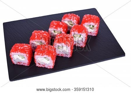 Traditional Fresh Japanese Sushi Rolls On A Black Stone California Ebi On A White Background. Roll I