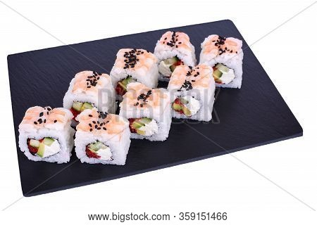 Traditional Fresh Japanese Sushi Rolls On A Black Stone Ebi Dragon On A White Background. Roll Ingre