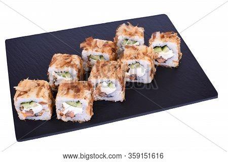 Traditional Fresh Japanese Sushi Rolls On A Black Stone Teka Kaji On A White Background. Roll Ingred