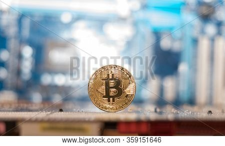 Electronic Cash. Bitcoin Currency On The Background Of A Computer Mainboard