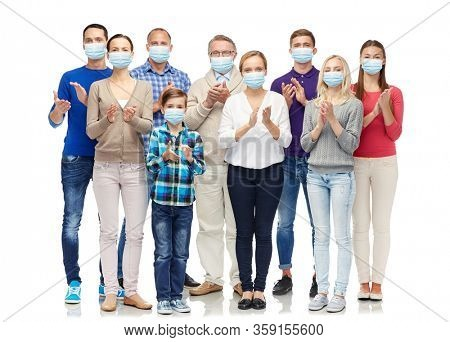 health, quarantine and pandemic concept - group of people wearing protective medical masks for protection from virus applauding
