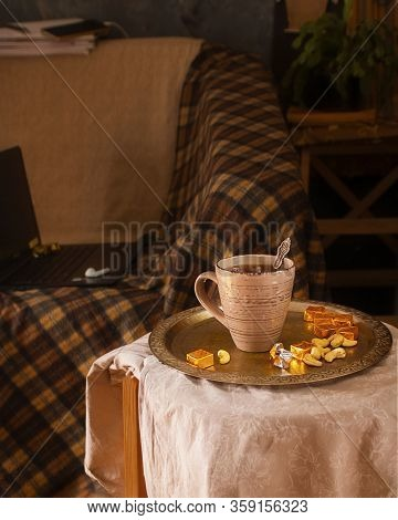 Cup Of Tea, Sweets On Vinage Tray On Stool And Thinks For Remote Work On Background. Stay At Home Co