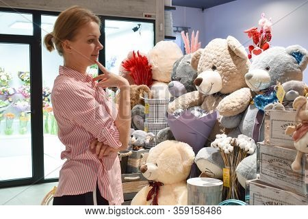 Moscow. Russia. March 2020. A Woman Chooses A Toy In The Store. Buying Toys In The Salon Of Gifts. A