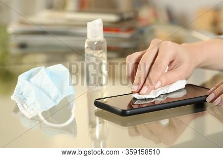 Close Up Of Girl Hand With Protective Mask Disinfecting With Sanitizer Gel Her Phone Screen Preventi