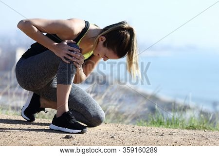 Injured Runner Complaining Alone Suffering Knee Ache On The Ground In City Outskirts
