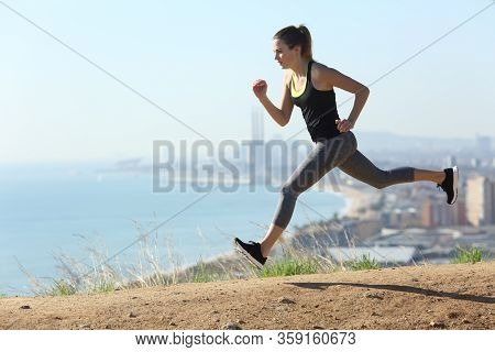 Runner Girl Running Fast In City Outskirts A Sunny Day