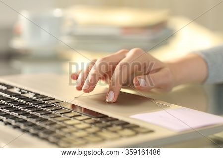 Close Up Of Woman Hand With Laptop Using Touchpad On A Desk At Home