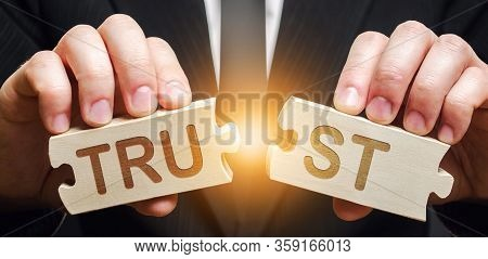 A Man Shares Two Puzzles With The Word Trust. Violation Of Agreements And Promises. Lose Credibility