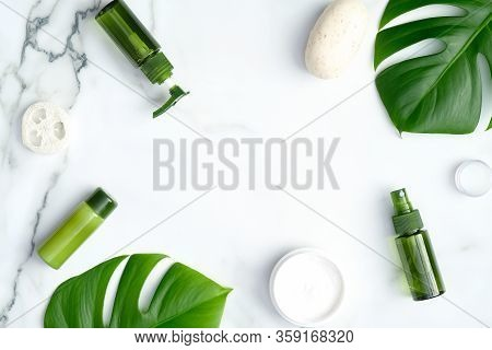 Spa Organic Beauty Products On Marble Background. Natural Cosmetics With Monstera Tropical Leaves. B