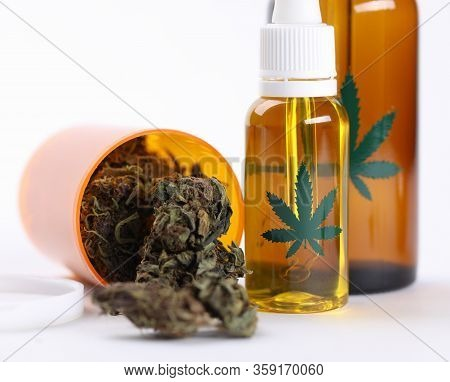 Closeup On Table Hemp Oil And Dried Cannabis Herb. Cannabis Is An Effective And Safe Treatment For M
