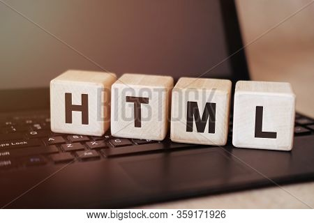Html Concept On Wooden Cubes On A Black Tablet