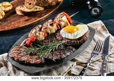 Grilled Meat Platter On A Plate With Grilled Vegetables, Grilled Meat. Food Photo, Dark Background
