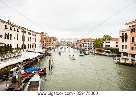 Venice. Italy - May 14, 2019: Boat Traffic on Grand Canal in Venice. Italy. View from Scalzi Bridge (Ponte degli Scalzi). Rainy Weather.