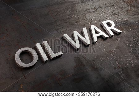 Words Oil War Laid In Line With Silver Metal Letters On Rusted Heavy Hot Rolled Uncoated Steel Sheet