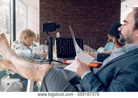Man Preparing Conference Call While Children Are Doing Homework - Smart Working And Teleworking Conc